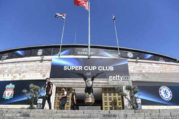 Special force police officers patrol in front of Besiktas Vodafone park stadium on August 10, 2019 ahead of the upcoming UEFA Super Cup football...