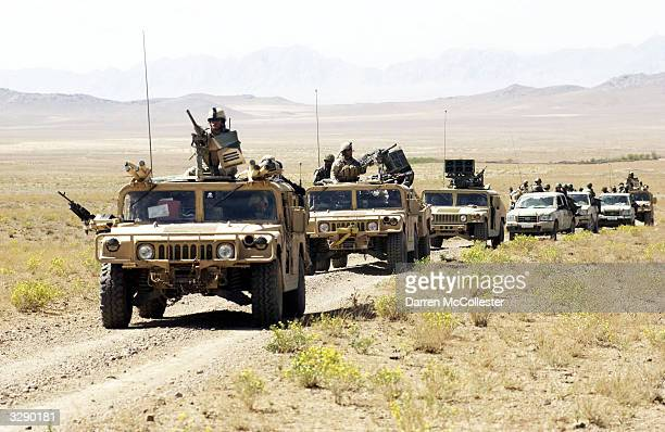 S Special Forces and Afghan National Army convoy rolls through the countryside on the way to conduct joint village searches with the Afghan National...