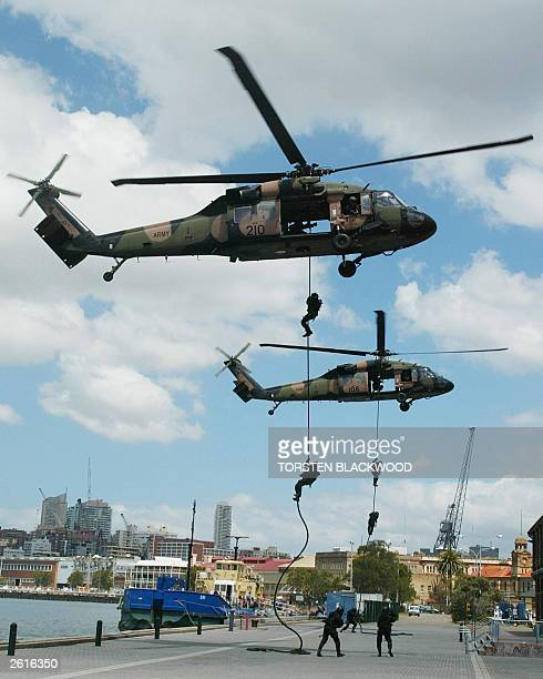 Special forces commandos rappel from two Black Hawk helicopters during a recruitment drive by the Australian Defence Force on Garden Island in Sydney...