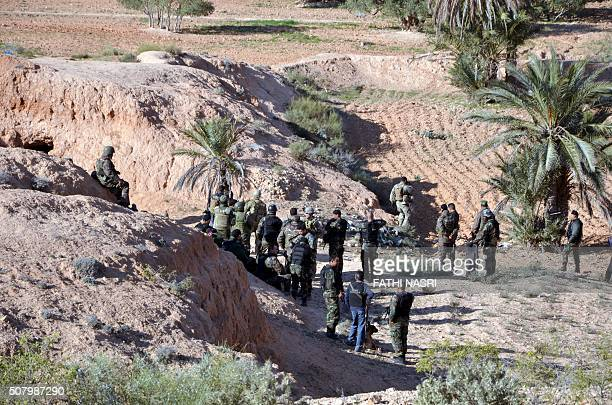 Special forces from the Tunisian National Guard and militaries take part in a security sweep in the mountainous Tounine area some 30 kilometres south...