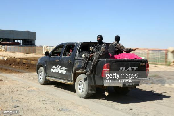 Special forces from the USbacked Syrian Democratic Forces made up of an alliance of Arab and Kurdish fighters inspect the Tabqa dam on May 12 after...