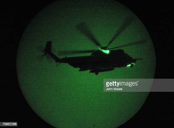 S Special Forces MH53 helicopter arrives to take US Navy SEALS on a night mission to capture Iraqi insurgent leaders July 27 2007 near Fallujah Iraq...