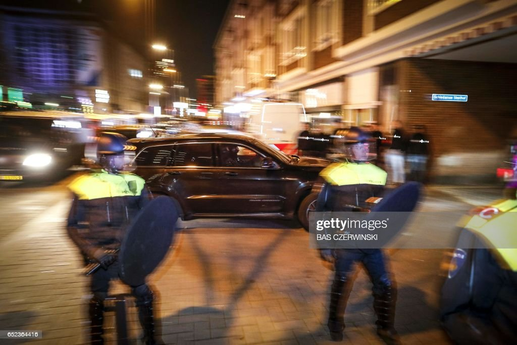 Special forces of the Dutch Police 'Dienst Speciale Interventies' (DSI) arrive at the Schiedamse Vesthof where the Turkish Family Minister Fatma Betul Sayan Kaya was barred by police from entering the Turkish consulate in Rotterdam, in the Netherlands on March 11, 2017. After initially dispersing, the crowd began to gather in smaller groups again, with the police once again moving in, an AFP correspondent said. The move came as the city's authorities expelled Turkey's Family Minister Fatma Betul Sayan Kaya and escorted her back to the German border. PHOTO / ANP / Bas Czerwinski / Netherlands OUT