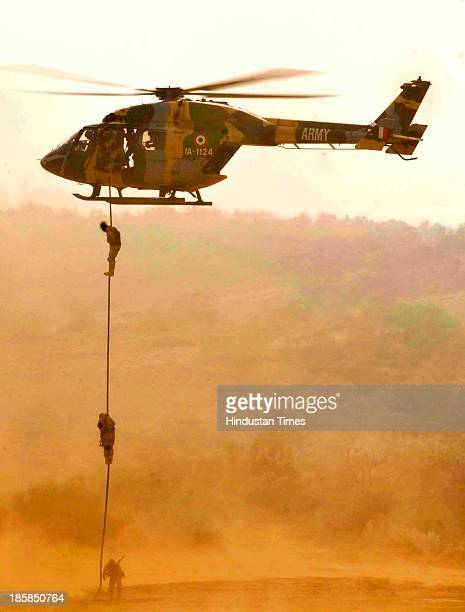 Special forces of the Indian Army and Russian Army slithering out of the Helicopter during the IndiaRussia Joint Exercise Indra2013 at Mahajan Firing...