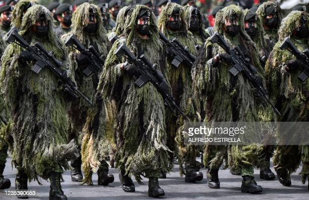 Special forces of the Mexican Army take part in the military parade for the 211th anniversary of the Independence Day at the Zocalo Square in Mexico...