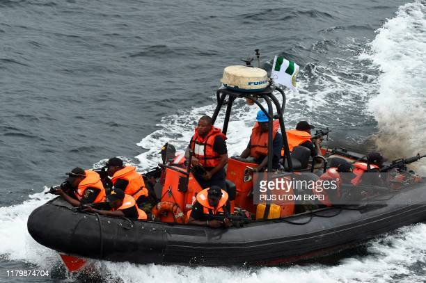 Special forces of the Nigerian navy sails to apprehend pirates in a mock operations during the five-day joint military exercise between Nigeria and...