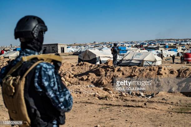 Special forces of the Syrian Democratic Forces keep watch on March 30, 2021 in the vicinity of al-Hol camp, the larger of two Kurdish-run...