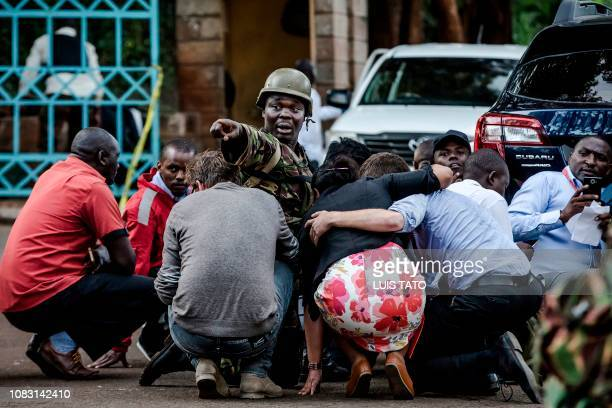 TOPSHOT Special forces protect people at the scene of an explosion at a hotel complex in Nairobi's Westlands suburb on January 15 in Kenya A huge...