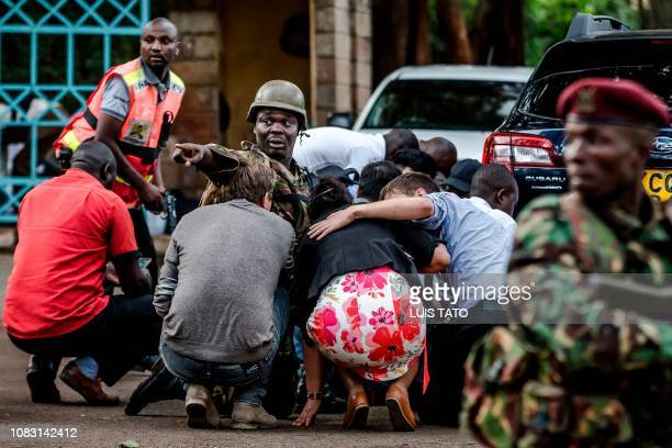 Special forces protect people at the scene of an explosion at a hotel complex in Nairobi's Westlands suburb on January 15 in Kenya A huge blast...
