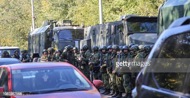 Special forces servicemen patrol a blast site at a college in the city of Kerch on October 17 2018 At least 18 people died in a blast in a technical...