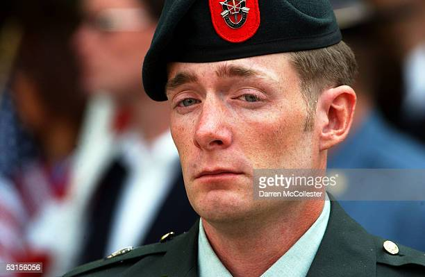 Special forces soldier grieves during a funeral for Army Staff Sgt. Christopher Piper June 27, 2005 in Marblehead, Massachusetts. Piper, a special...