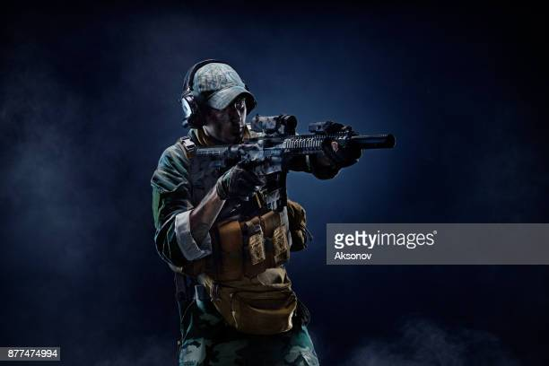 special forces soldier in action. portrait of a soldier - swat stock pictures, royalty-free photos & images
