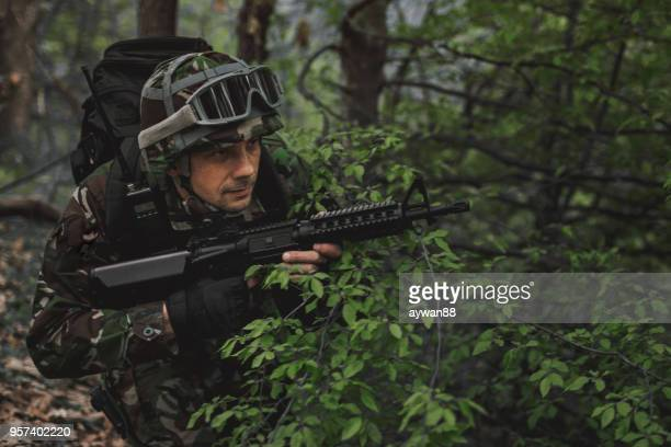 Special forces soldier in the wood