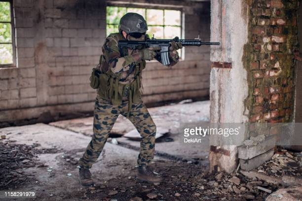 special forces soldier - boots rifle helmet stock pictures, royalty-free photos & images