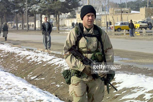 S special forces soldier walks along the streets of MazareSharif December 4 2001 in Afghanistan About two dozen US military personnel are stationed...