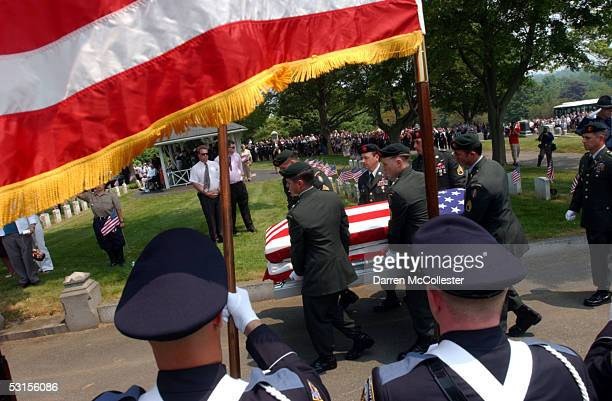 Special Forces soldiers carry the casket of their fallen comrade, Army Staff Sgt. Christopher Piper June 27, 2005 during his funeral procession in...
