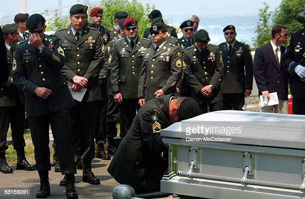Special Forces soldiers grieve over the casket of their fallen comrade, Army Staff Sgt. Christopher Piper June 27, 2005 during his funeral in...
