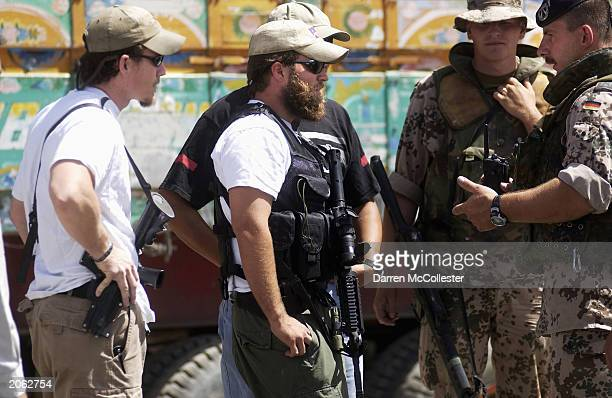 S special forces soldiers talk with German International Security Assistance Force soldiers June 7 2003 in Kabul Afghanistan At least six German ISAF...