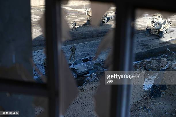 Special Forces stand guard at the scene of a car bomb attack in the PoleCharkhi area of the Afghan capital Kabul on February 10 2014 An explosion...