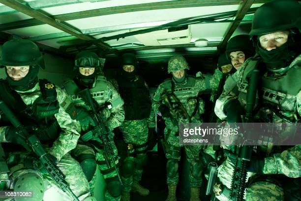Special forces tactical unit preparing for raid