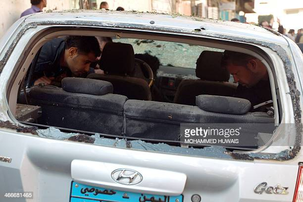 Special guard from the French Embassy inspect a damaged car at the site of an explosion near former president Ali Abdullah Saleh's house which is...