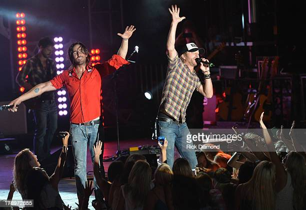 Special guest Dierks Bentley joins Jake Owen to perform in front of a crowd of over 10000 fans during Jake Owen summer block and party at BMI back...