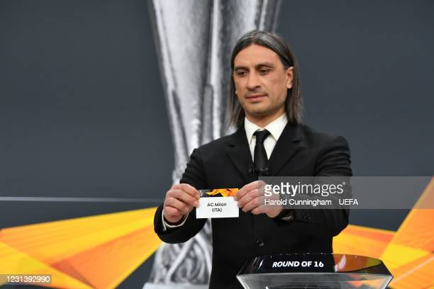 Special guest Hakan Yakin draws out the name of AC Milan during the UEFA Europa League 2020/21 Round of 16 draw at the UEFA Headquarters, the House...