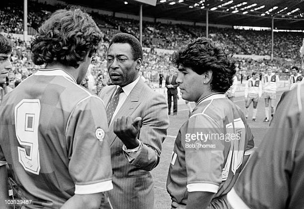 Special guest of honour Pele speaking to Michel Platini as Diego Maradona listens in prior to the Football League Centenary match between the...