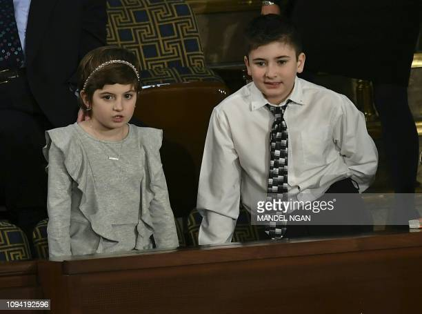 Special guests of President Donald Trump Grace Eline and Joshua Trump are seen in their seats ahead of US President Donald Trump's State of the Union...