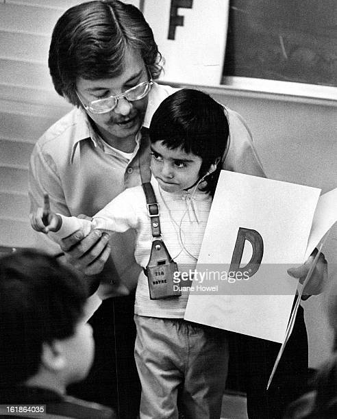 OCT 27 1972 NOV 23 1972 A special kind of teacher helps a special pupil Narye Sanchez a deaf pupil at the Fletcher Miller Special Education School in...
