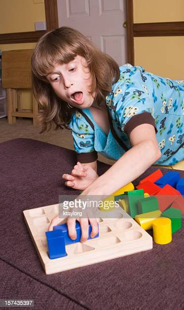 Special little girl playing with blocks