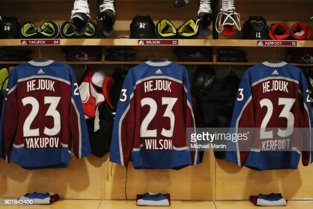 Special Milan Hejduk jerseys hang from lockers prior to the Milan Hejduk jersey retirement ceremony before the game between the Colorado Avalanche...