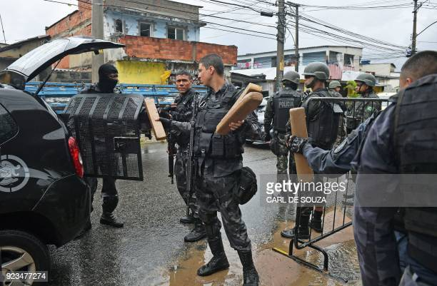 Special military police shock troops inspect move seized packages of drugs near the Vila Kennedy favela in Rio de Janeiro on February 23 2018 More...