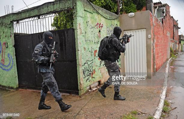 Special military police shock troops patrol near the Vila Kennedy favela in Rio de Janeiro on February 23 2018 More than 3000 soldiers supported Rio...
