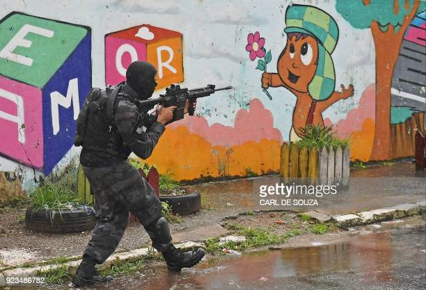 Special military police shock troops patrol near the Vila Kennedy favela in Rio de Janeiro Brazil on February 23 2018 More than 3000 soldiers...
