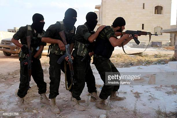 Special military units formed by Islamic Front to battle against Assad regime forces get military training in Idlib Syria on 24 September 2014