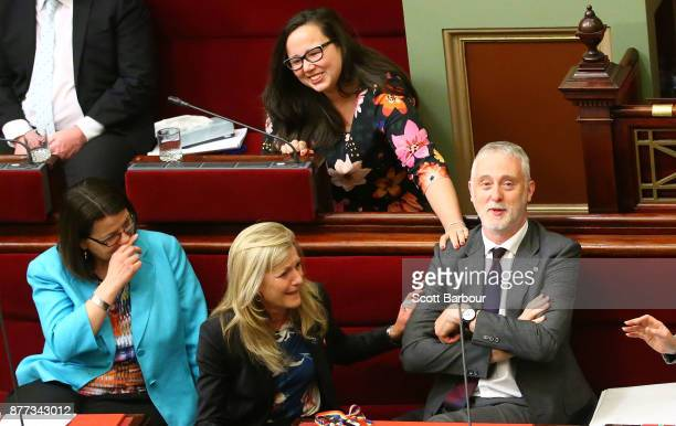 Special minister of state Gavin Jennings is congratulated by Harriet Shing MP and Fiona Patten MP as the bill passes inside of the Parliament of...