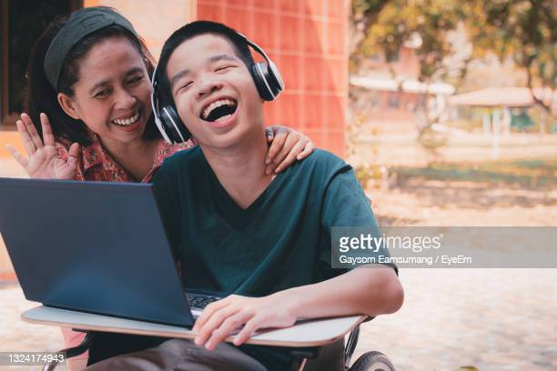 special need child on wheelchair use a tablet in the house with his parent, study at home - leaning disability stock pictures, royalty-free photos & images