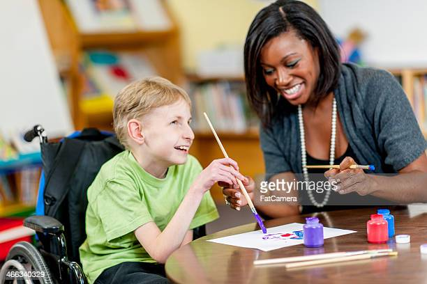 special needs boy - social services stock photos and pictures