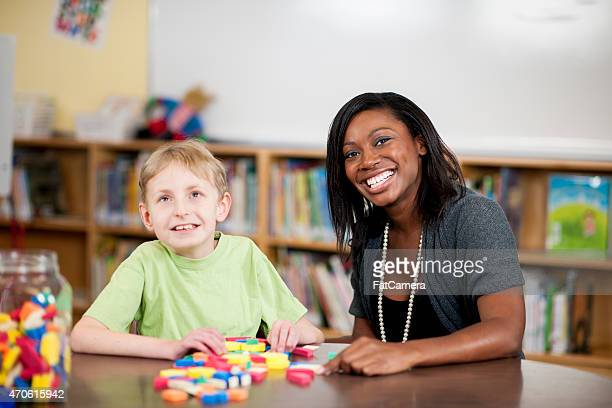 Special Needs Boy Playing with Toys