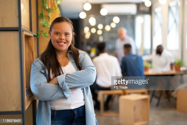 special needs businesswoman portrait at modern startup company - down syndrome stock pictures, royalty-free photos & images