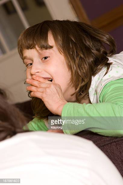 Special needs little girl smiling at therapist