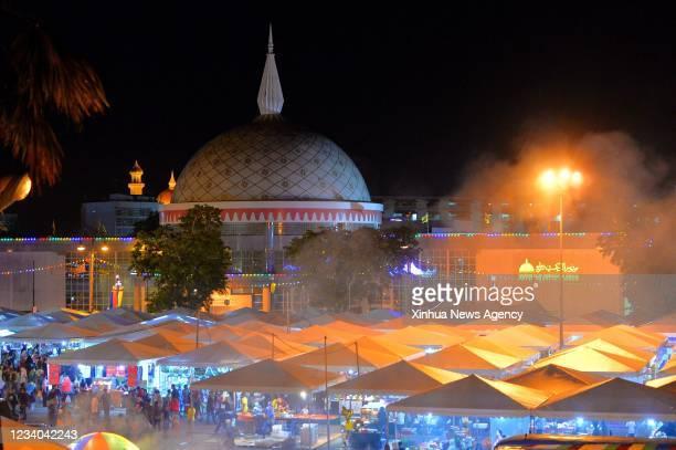 Special night market is organized for Sultan Haji Hassanal Bolkiah's 75th birthday celebration in Bandar Seri Begawan, capital of Brunei, on July 16,...