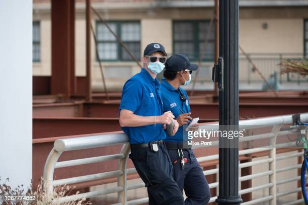 Special officers wearing protective face masks patrol the beach and boardwalk during Phase 4 of re-opening following restrictions imposed to slow the...
