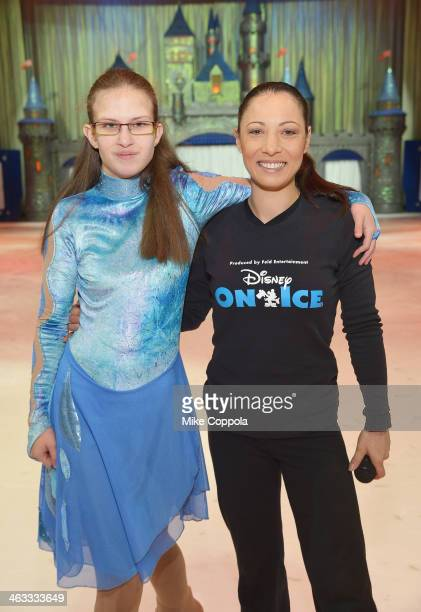 Special Olympian poses for a picture with former Olympian and Disney On Ice cast member Natasha Kuchiki at Prudential Center on January 17 2014 in...