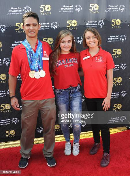 Special Olympics athletes Brett Laza and Kyla Schilz pose with Alyssa de Boisblanc at Special Olympics Pier Del Sol held at Pacific Park on the Santa...