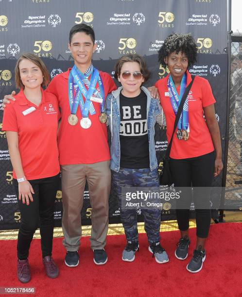 Special Olympics athletes Brett Laza Kyla Schilz and Krystal Johnson pose with Bryson Robinson at the Special Olympics Pier Del Sol held at Pacific...