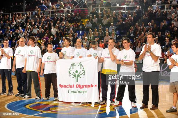 Special Olympics Athletes pose with players before the 20112012 Turkish Airlines Euroleague Regular Season Game Day 6 between FC Barcelona Regal v...