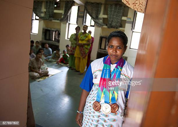 Special Olympics Gold and Bronze medalist Phoolan Devi poses for a profile shoot on August 14 2015 in New Delhi India Phoolan Devi has an IQ of 46...