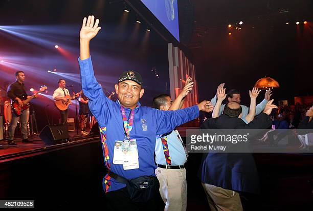 Special Olympics World Games Global Messanger Marco Martinez leads a conga line during the performace of the CocaCola Unified song Reach Up at...